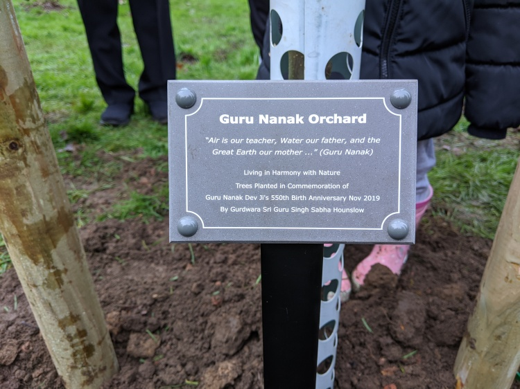 Special plaque naming the orchard the Guru Nanak Orchard.